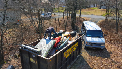 Here's Nick crawling around the top of the dumpster getting a mattress tucked in there. I would have been up a creek without his help. Thanks bro!!!