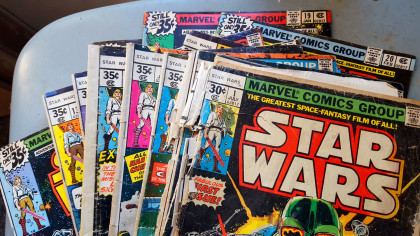 My vintage Star Wars comics from the 70's complete with rusty staples and ripped pages. They've been in beat up condition for years but they're my originals so I'm obligated to keep them ;)